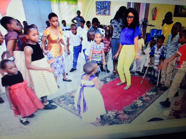 TV host Princess Halliday and physically disabled children in Africa